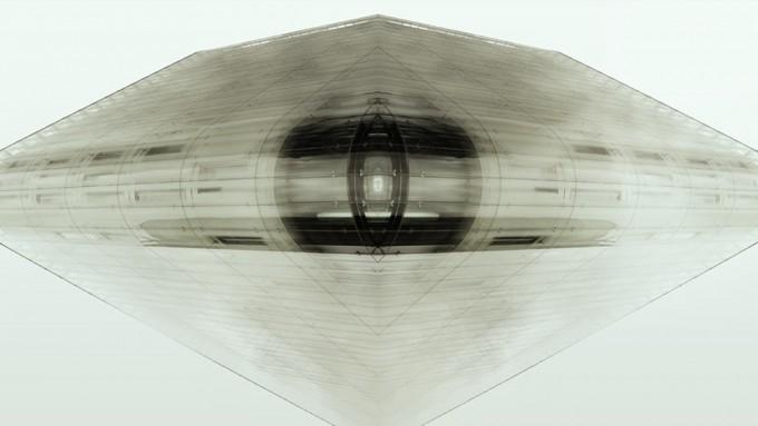 Art impression of a triangular glass building shape