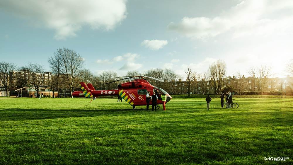 Red ambulance helicopter on the grass field - 芝生に赤い救急ヘリコプター SKU: mo-0018