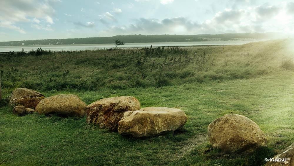 Big rocks in the green grass field SKU: la-0077