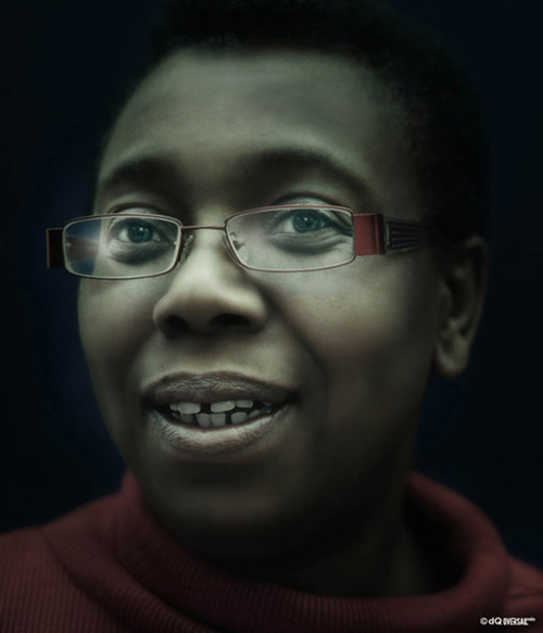 Portrait of a smiling black woman in a red sweater wearing red glasses SKU: po-0007